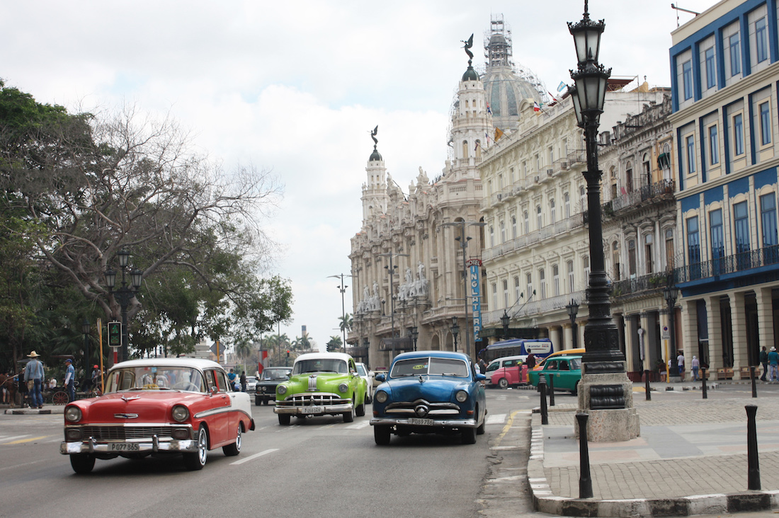 Classic Cars at intersection in Havana Cuba